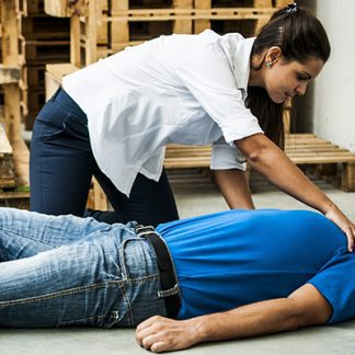 Lady training Aware in Emergency First Aid at Work in Glasgow