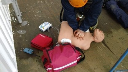 Person training in CPR with a dummy