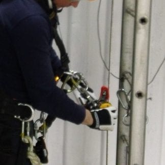 Man attaching harness working at height